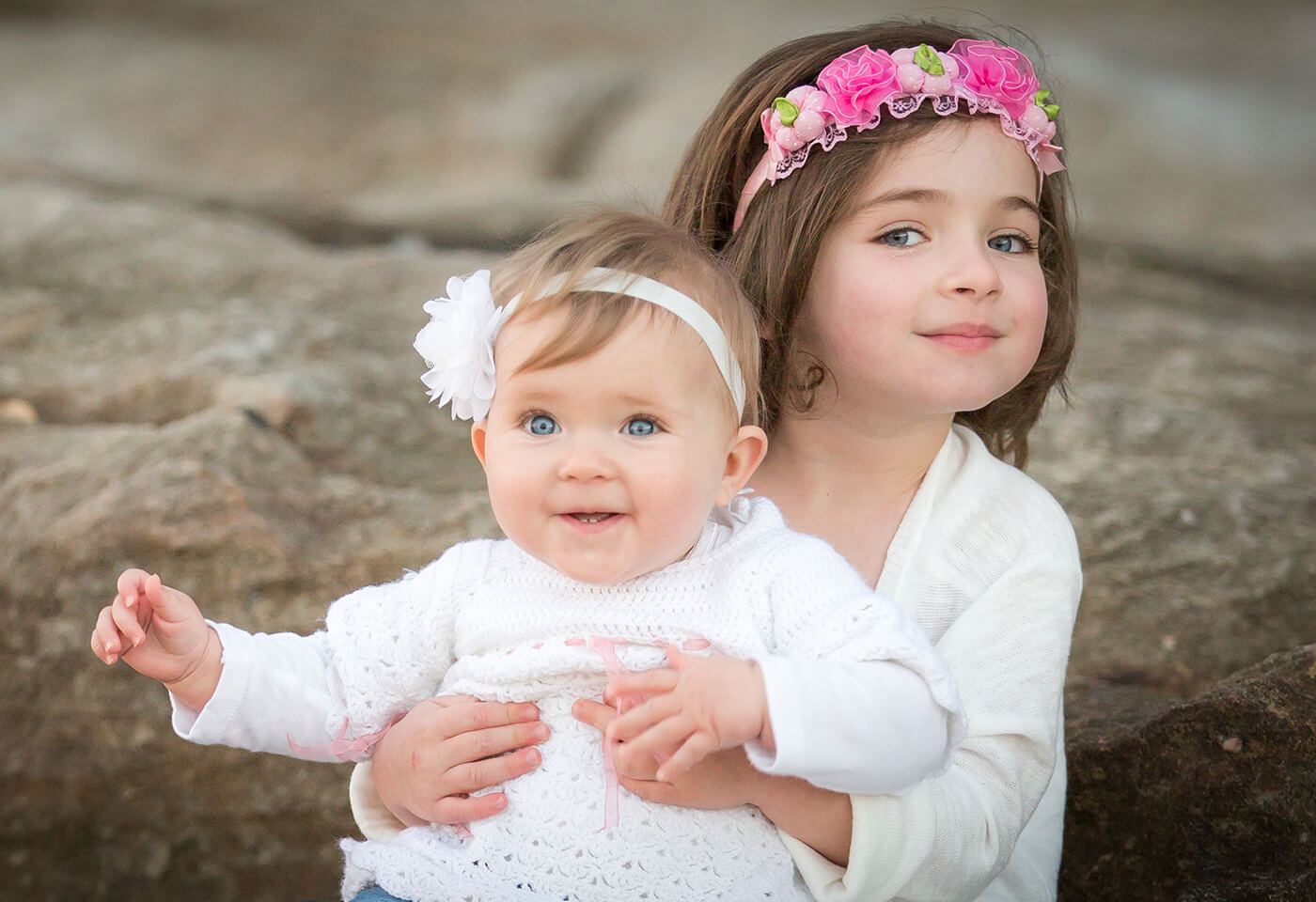Girl with flower crown and her baby sister