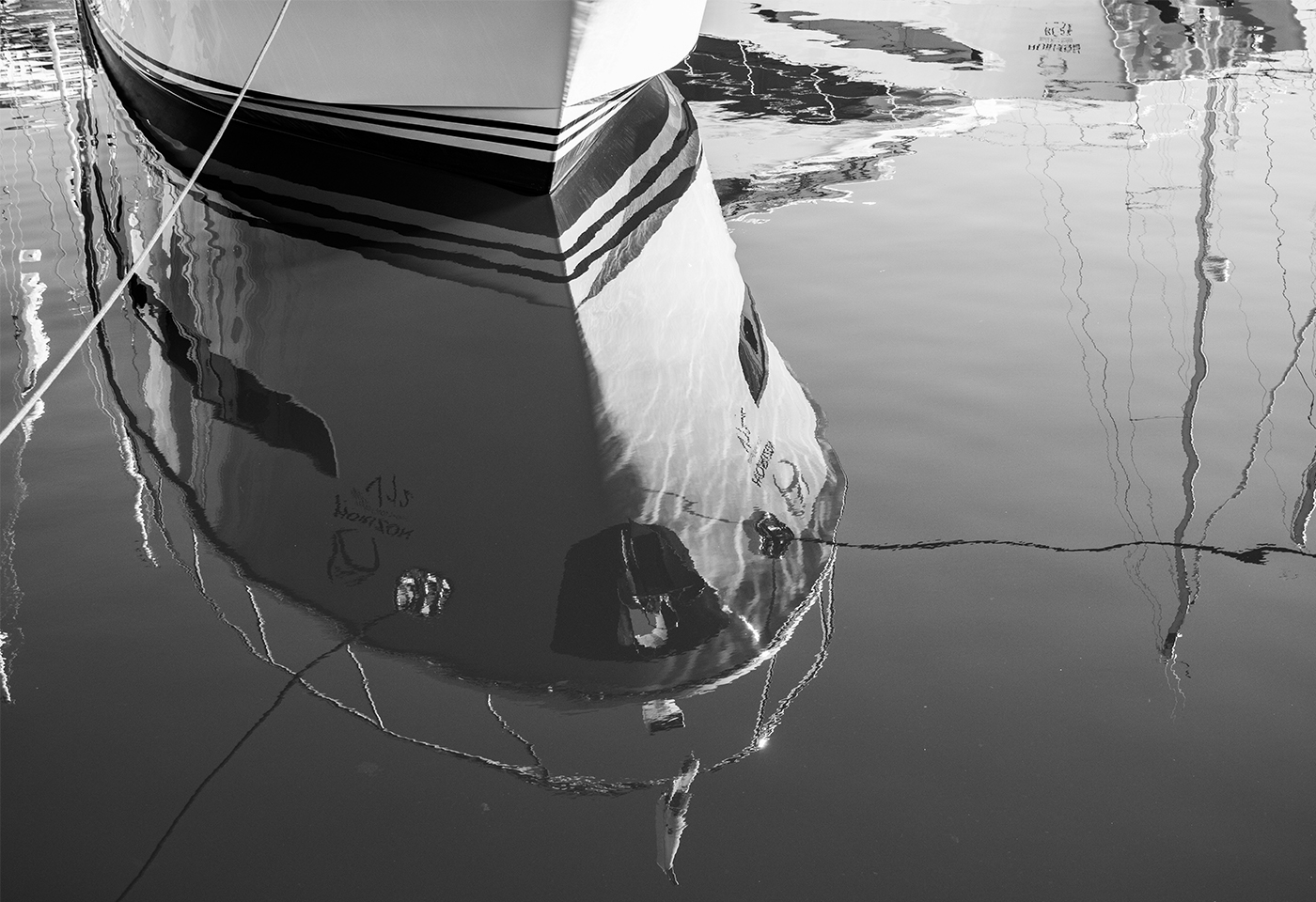Black and white reflection of boat on water