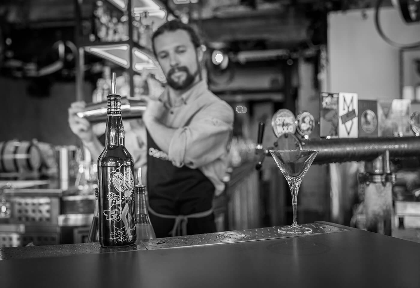 Black and white portrait image of bartender