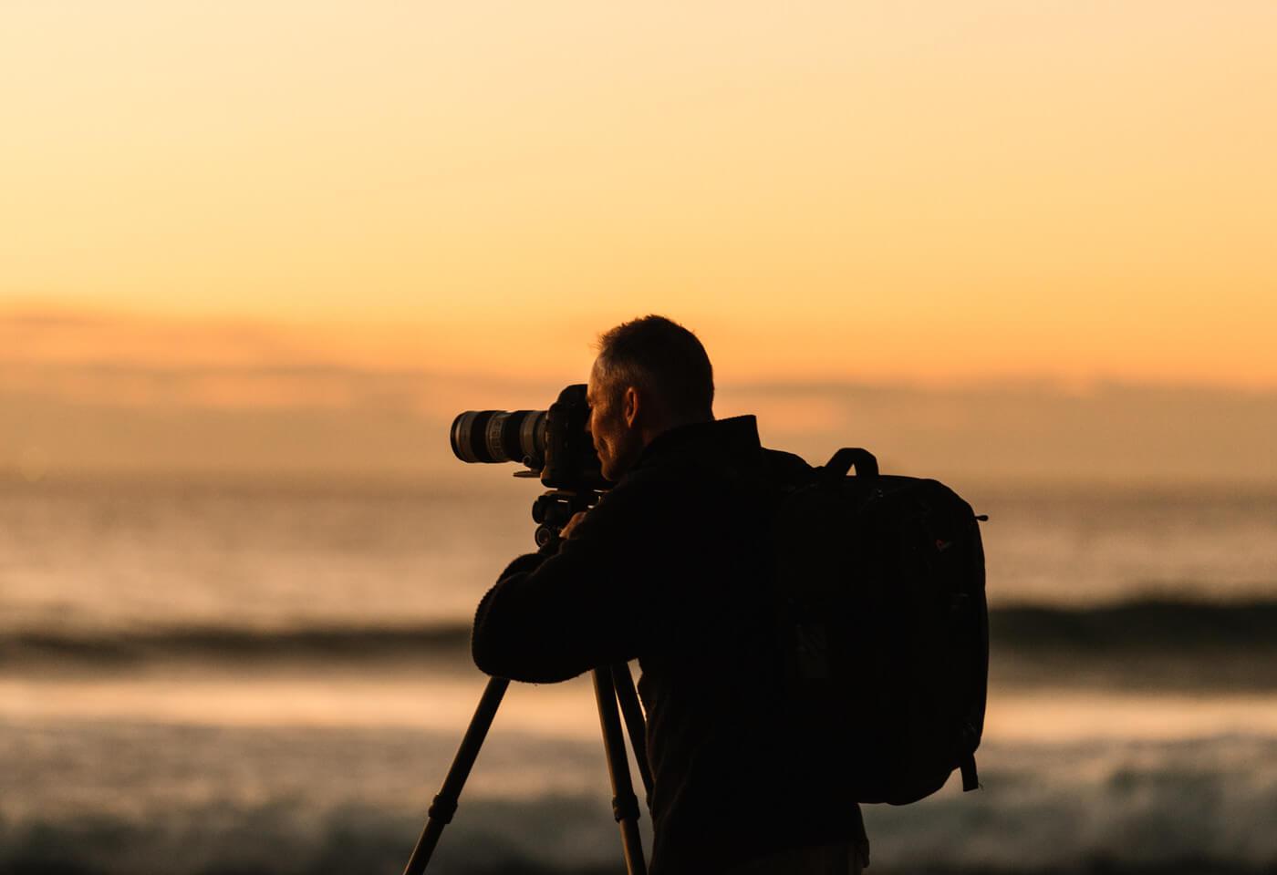 Man photographing sunrise