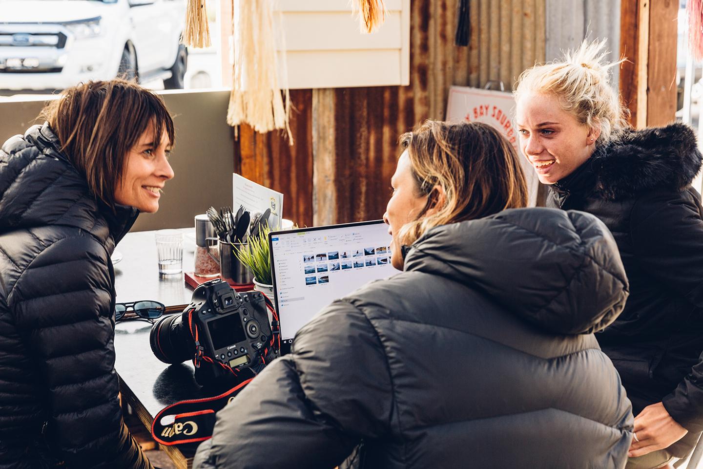 Fran Miller, Belinda Baggs and Macy Callaghan reviewing content