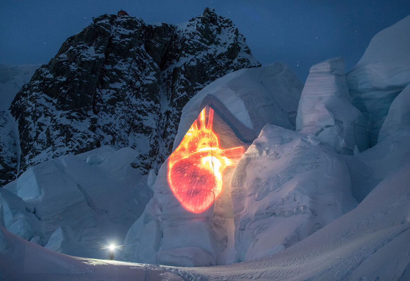 Heart image projected on glacier