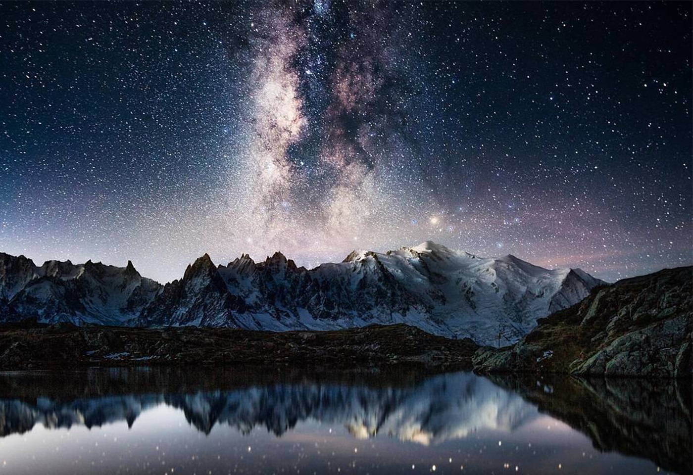 image of river foreground, mountains and milky way