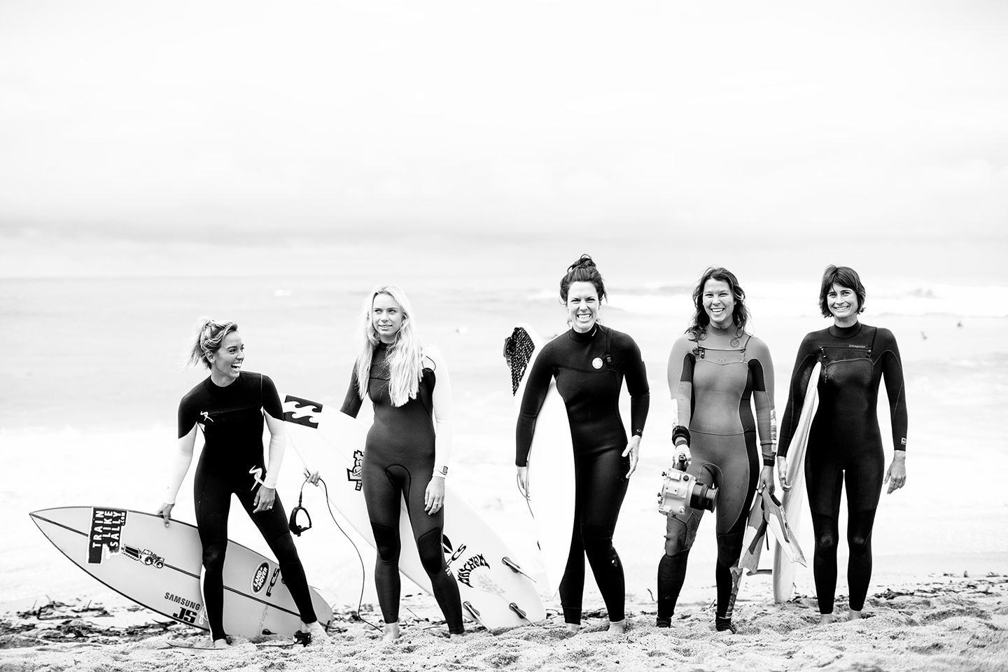 Black and white photo of female surfers