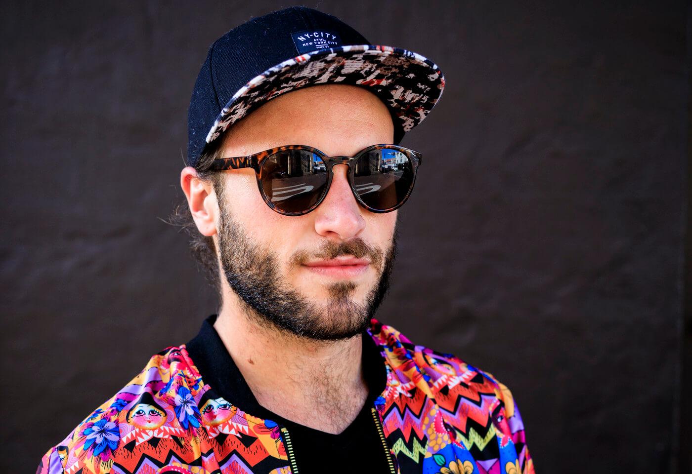Portrait of man on street wearing sunglasses