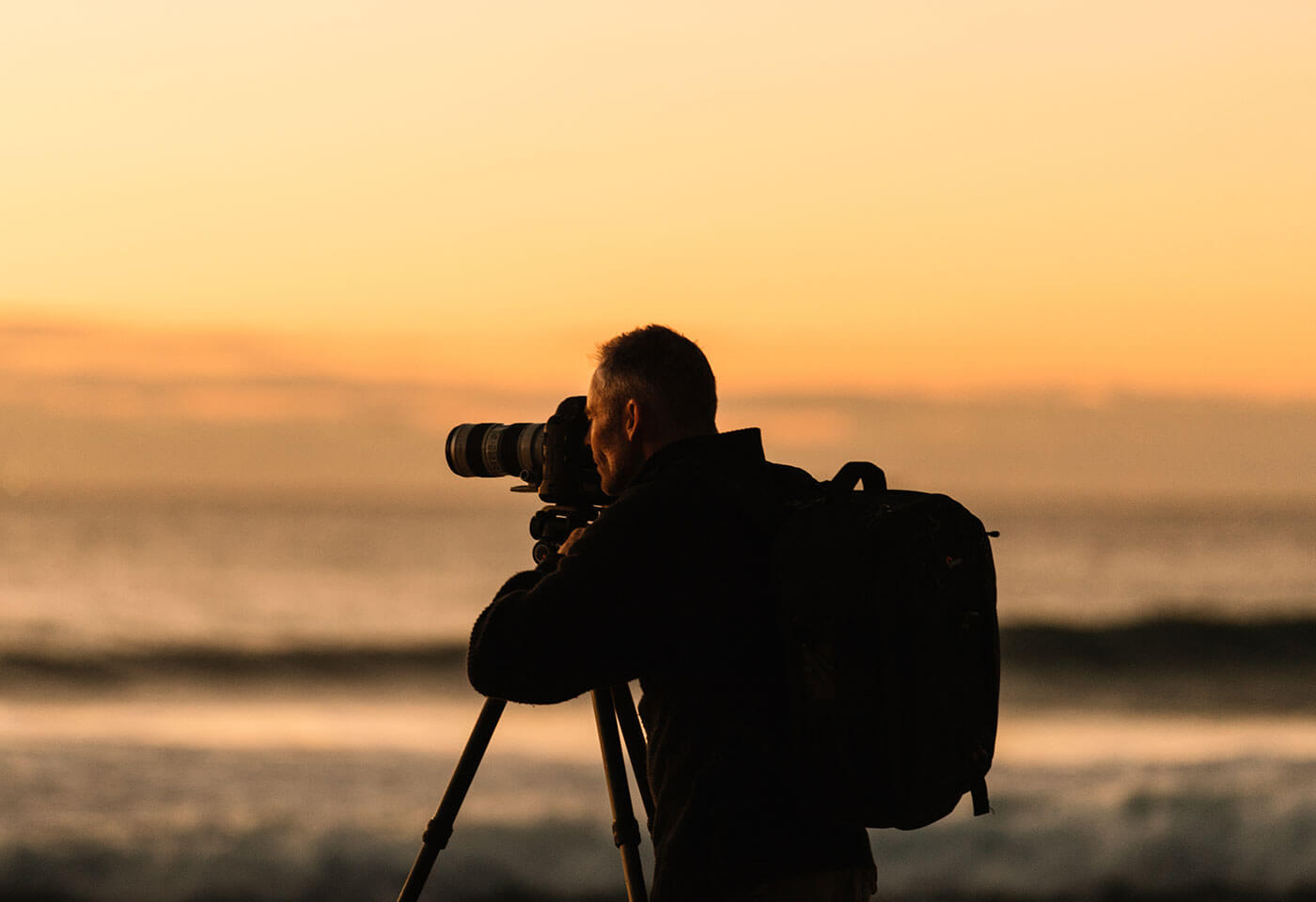 Photographer taking a sunset photograph