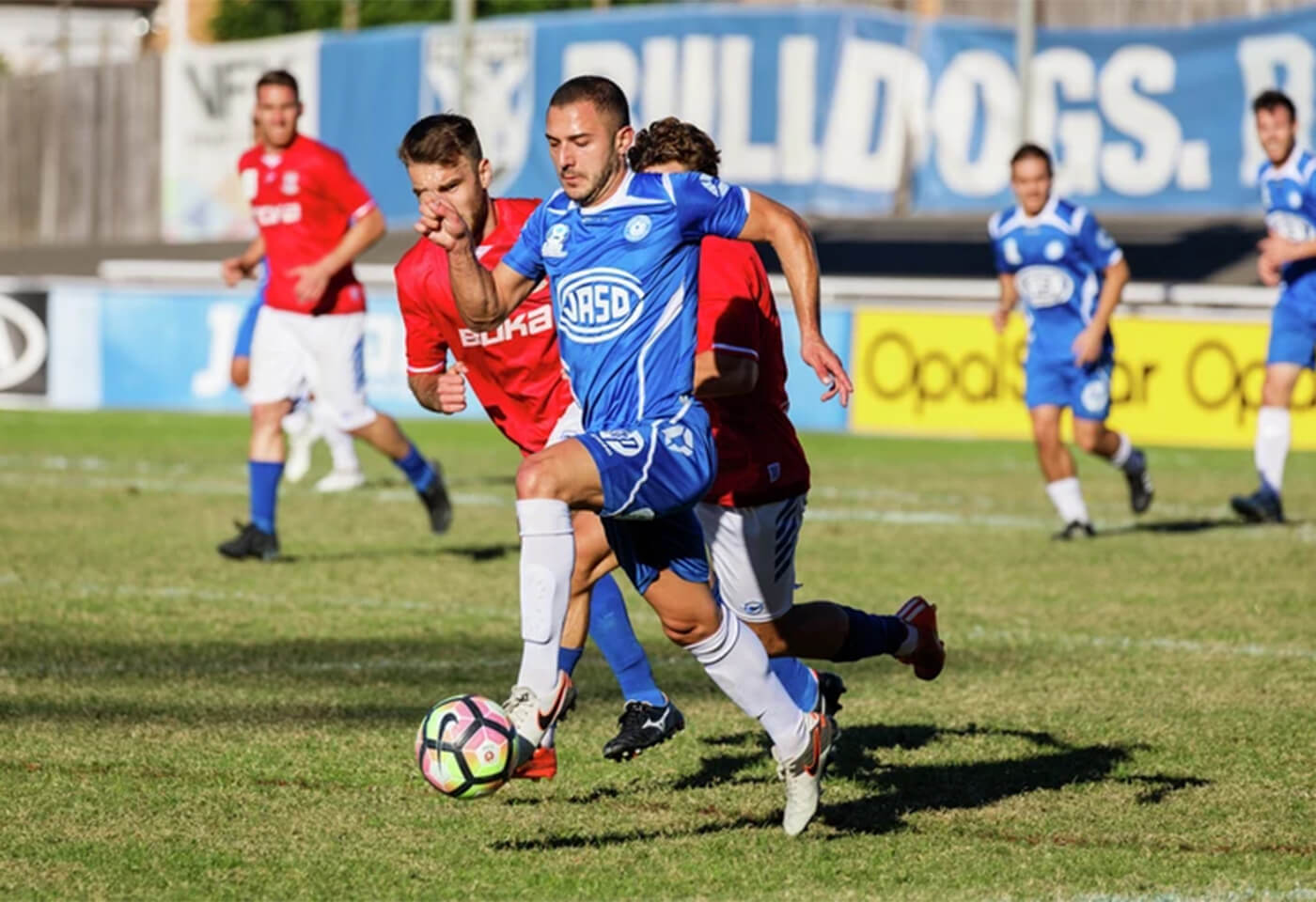Image of men playing soccer