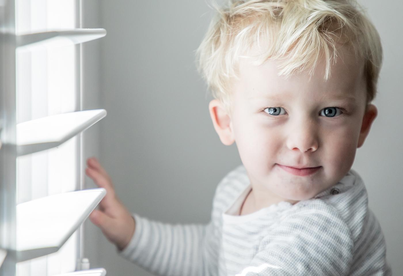 boy at blind portrait image