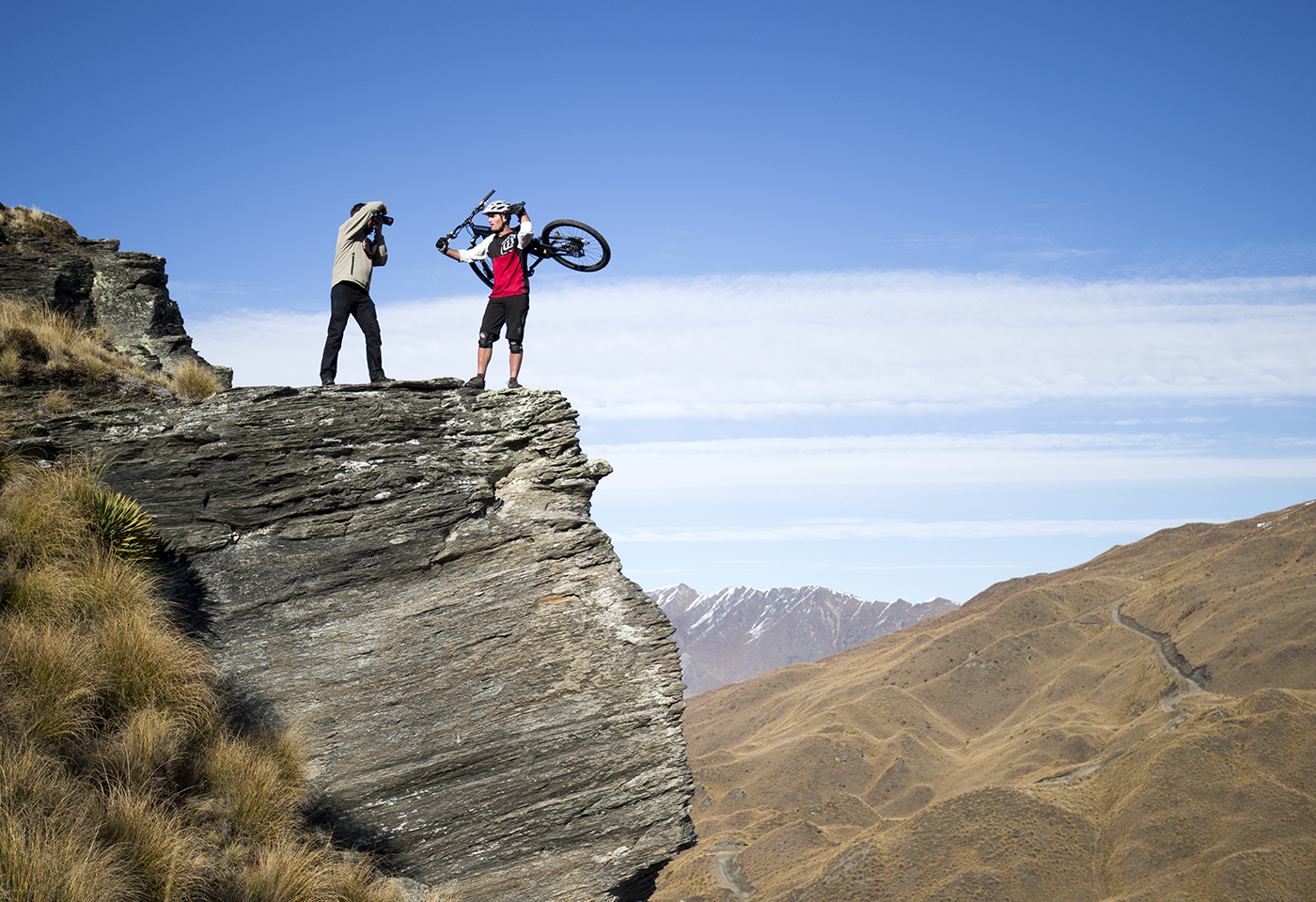 Photographer and mountain bike rider on mountain