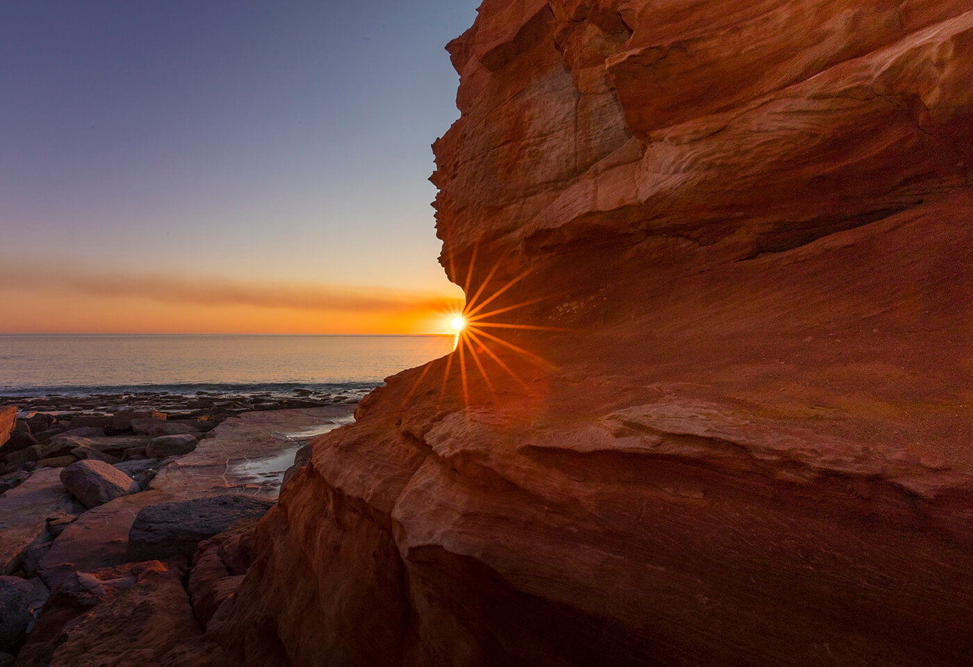 Sunset behind cliff
