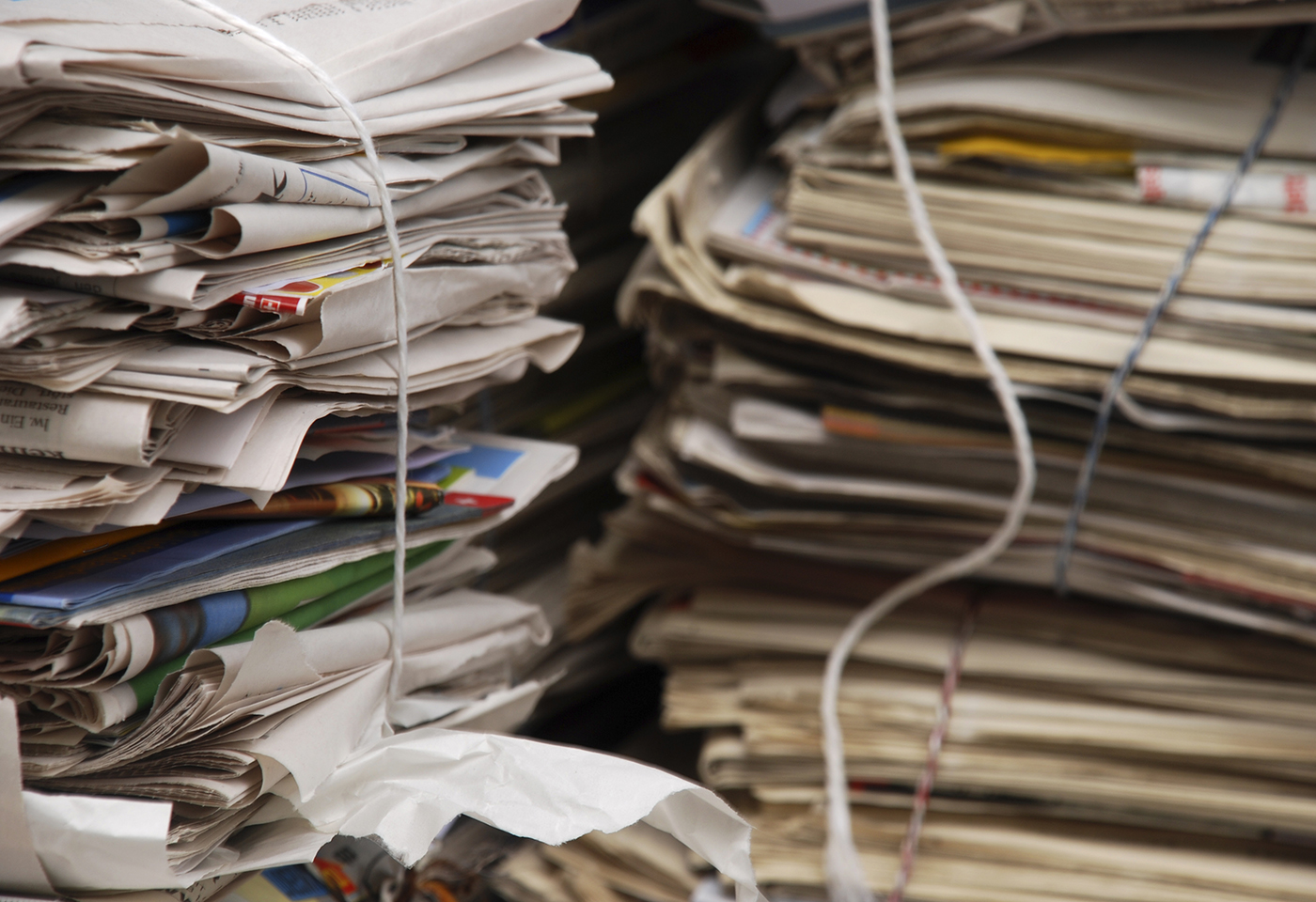 Stacks of newspaper and paper