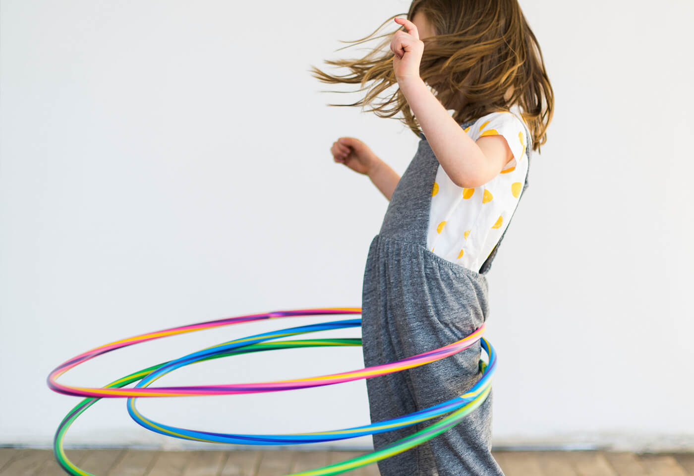Child with hula hoops
