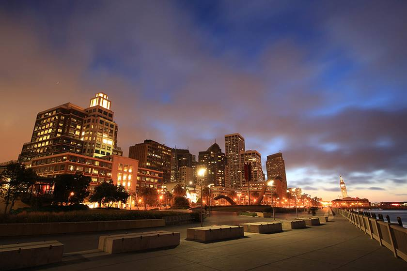 Image of a city illuminated at dusk taken with the Canon EF 11-24mm f4L USM wide zoom lens
