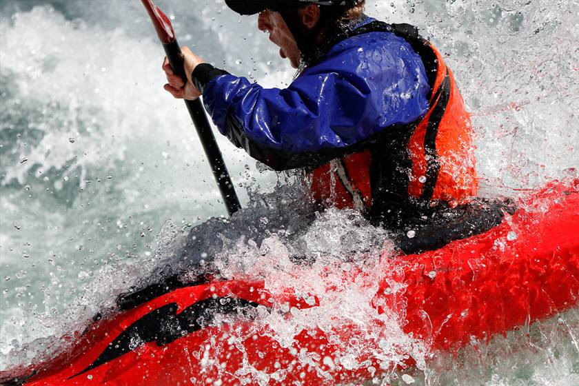 Man kayaking in water