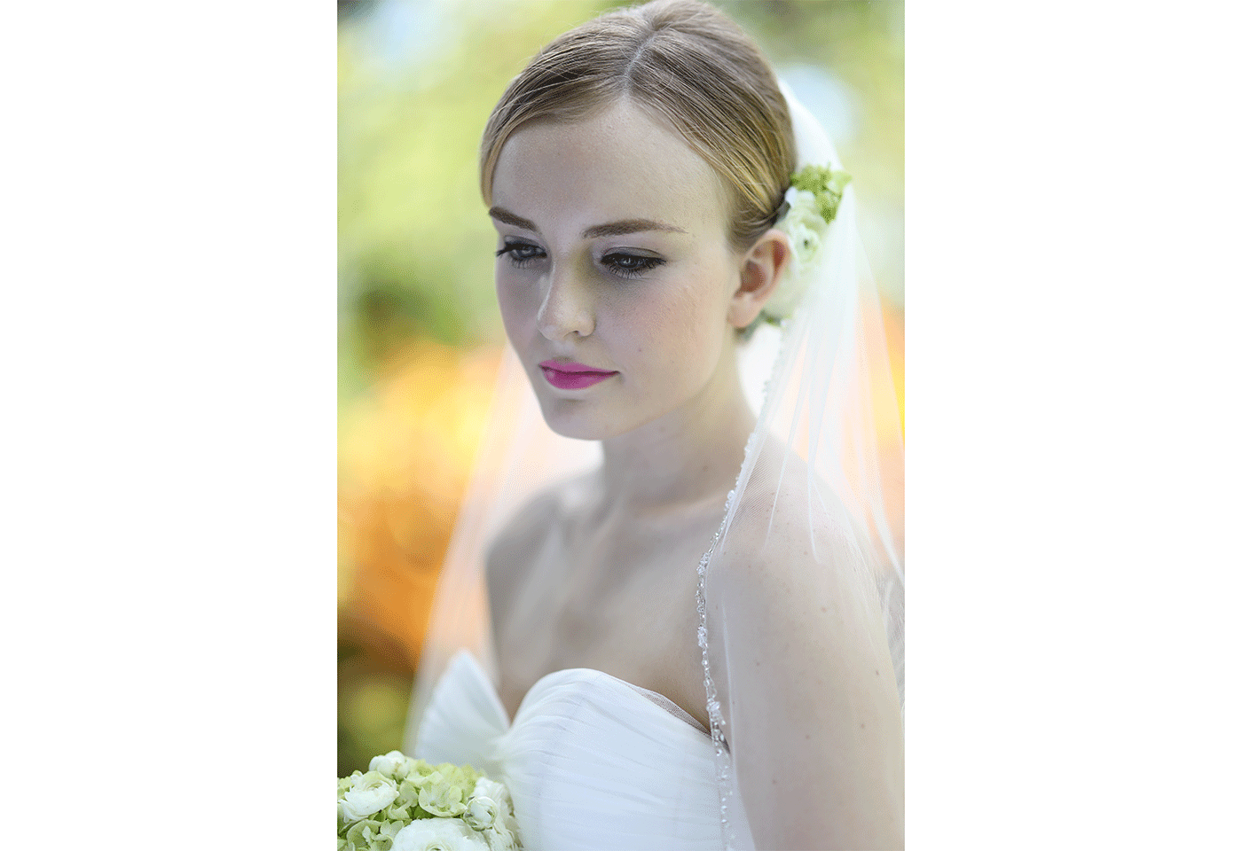 Portrait image of bride looking down