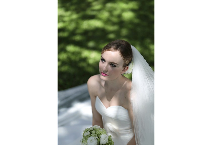Portrait image of bride sitting down