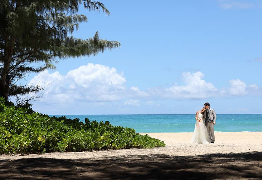 landscape image of wedding couple on beach