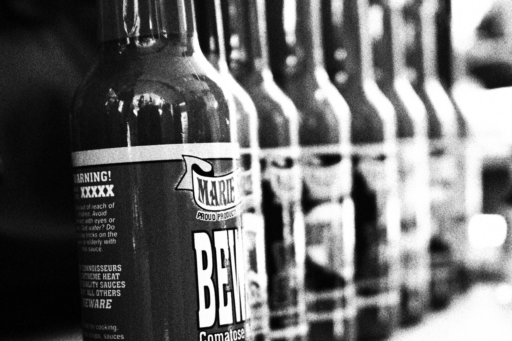 Beer bottles in black and white taken on Canon EOD100D DSLR camera