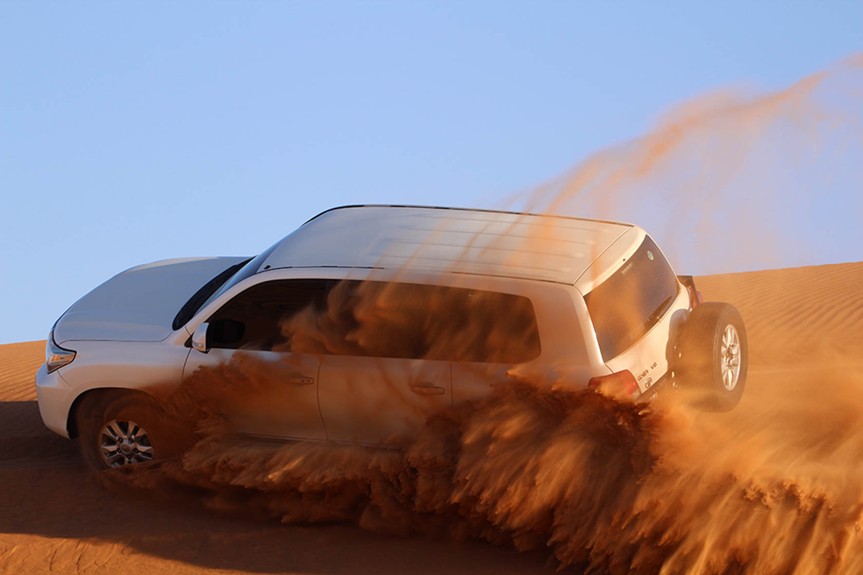 White 4X4 driving through sand dunes taken with Canon EOS 1300D DSLR camera