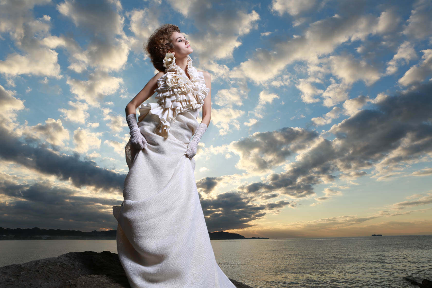 Model in white dress under clouds taken on Canon EOS 5D Mark III DSLR camera