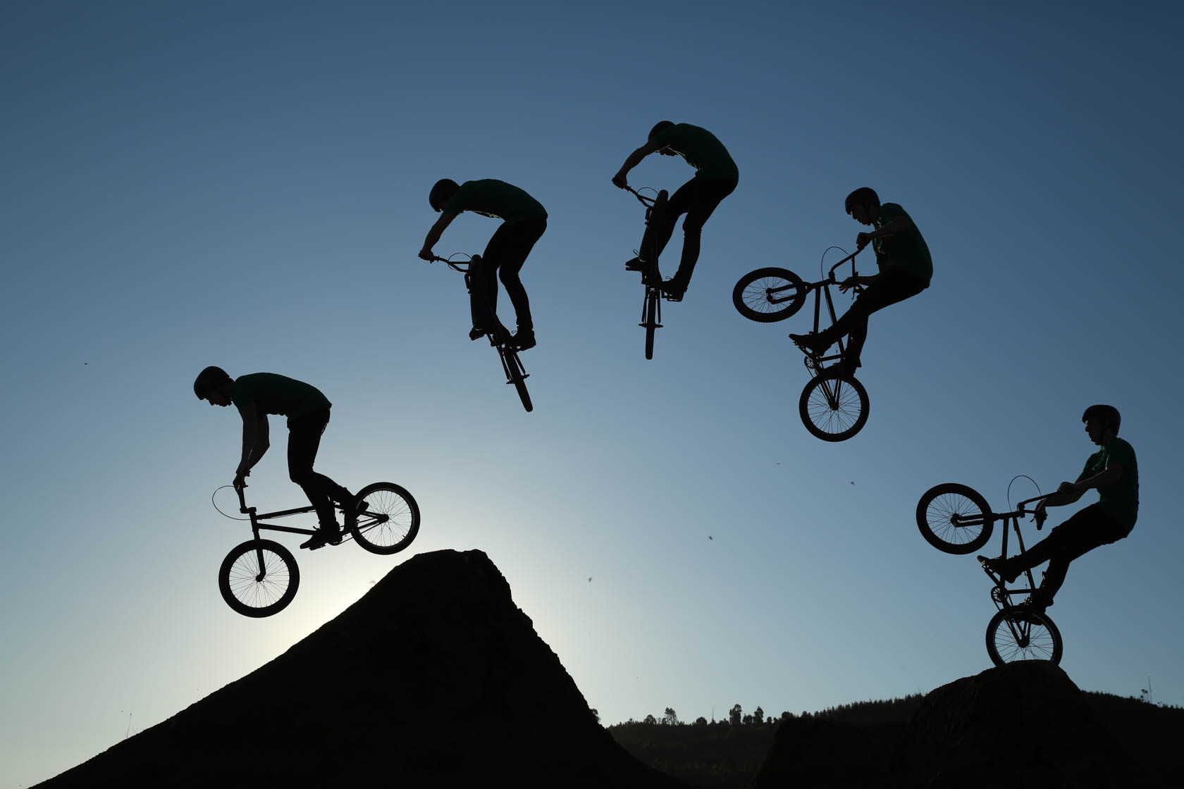 Silhouette of BMX riders taken on Canon EOS 5D Mark III DSLR camera