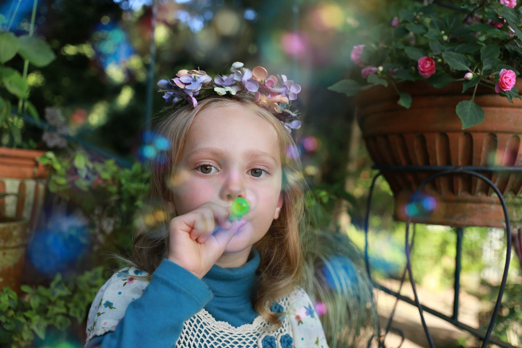Girl blowing bubbles taken with Canon EOS 6D DSLR camera