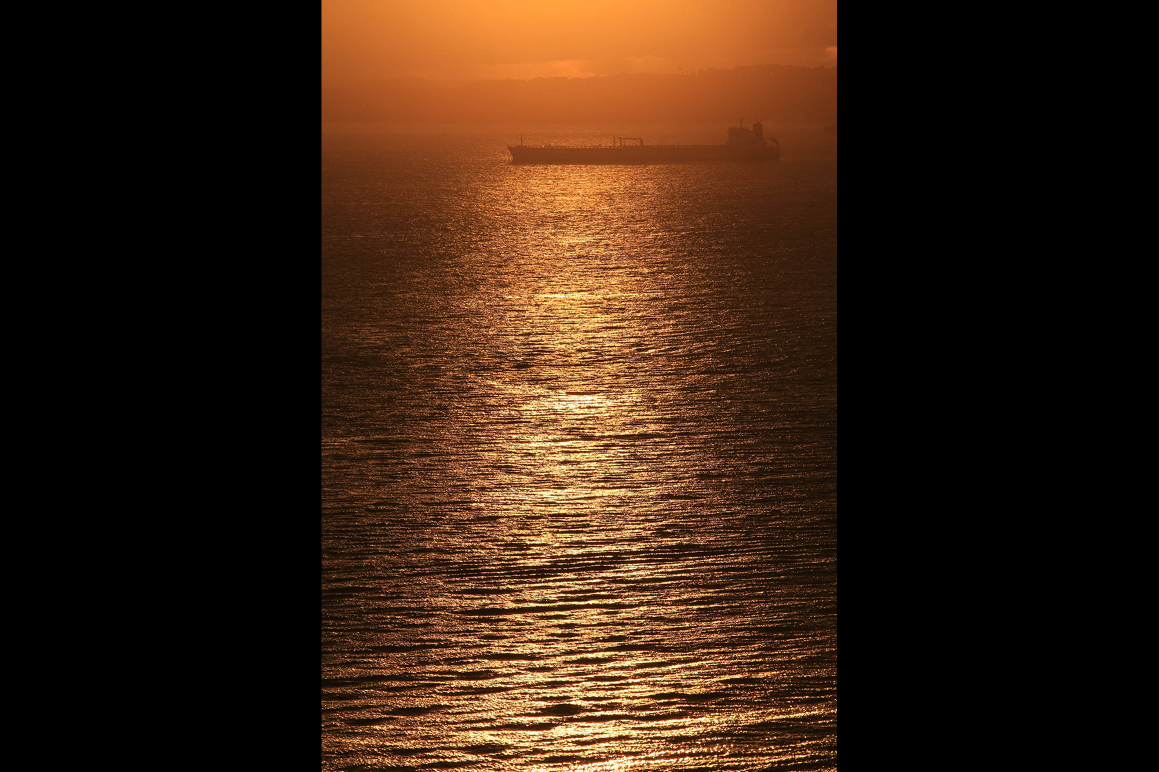 Sunset over ocean taken with Canon EOS 70D DSLR camera