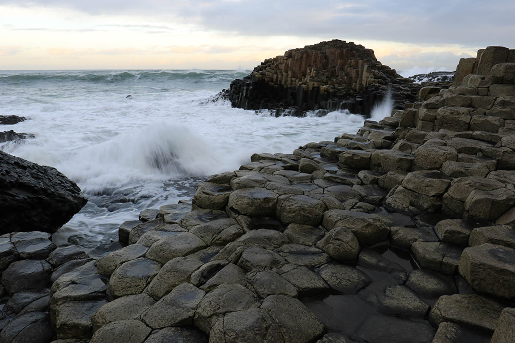 Waves crashing on rocks taken with the Canon EOS 750D digital SLR camera