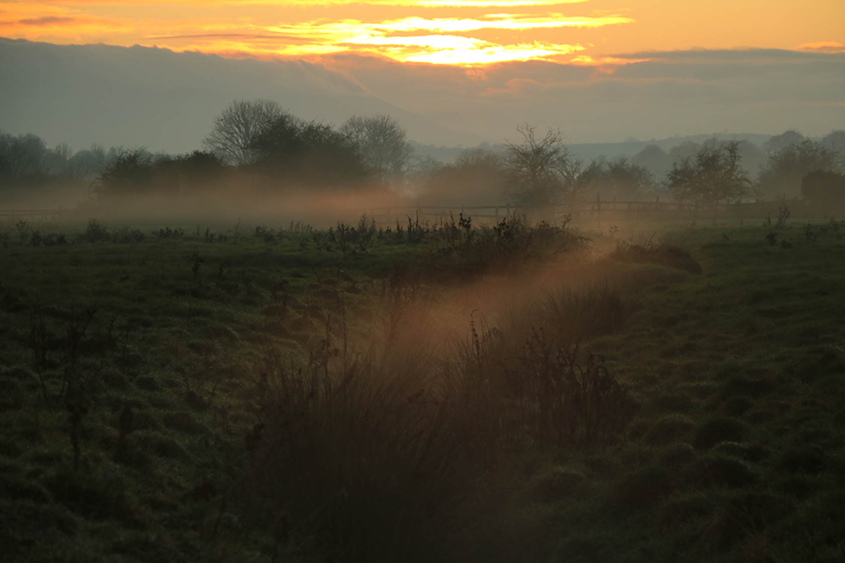 Sun rising over a field taken with the Canon EOS 750D digital SLR camera