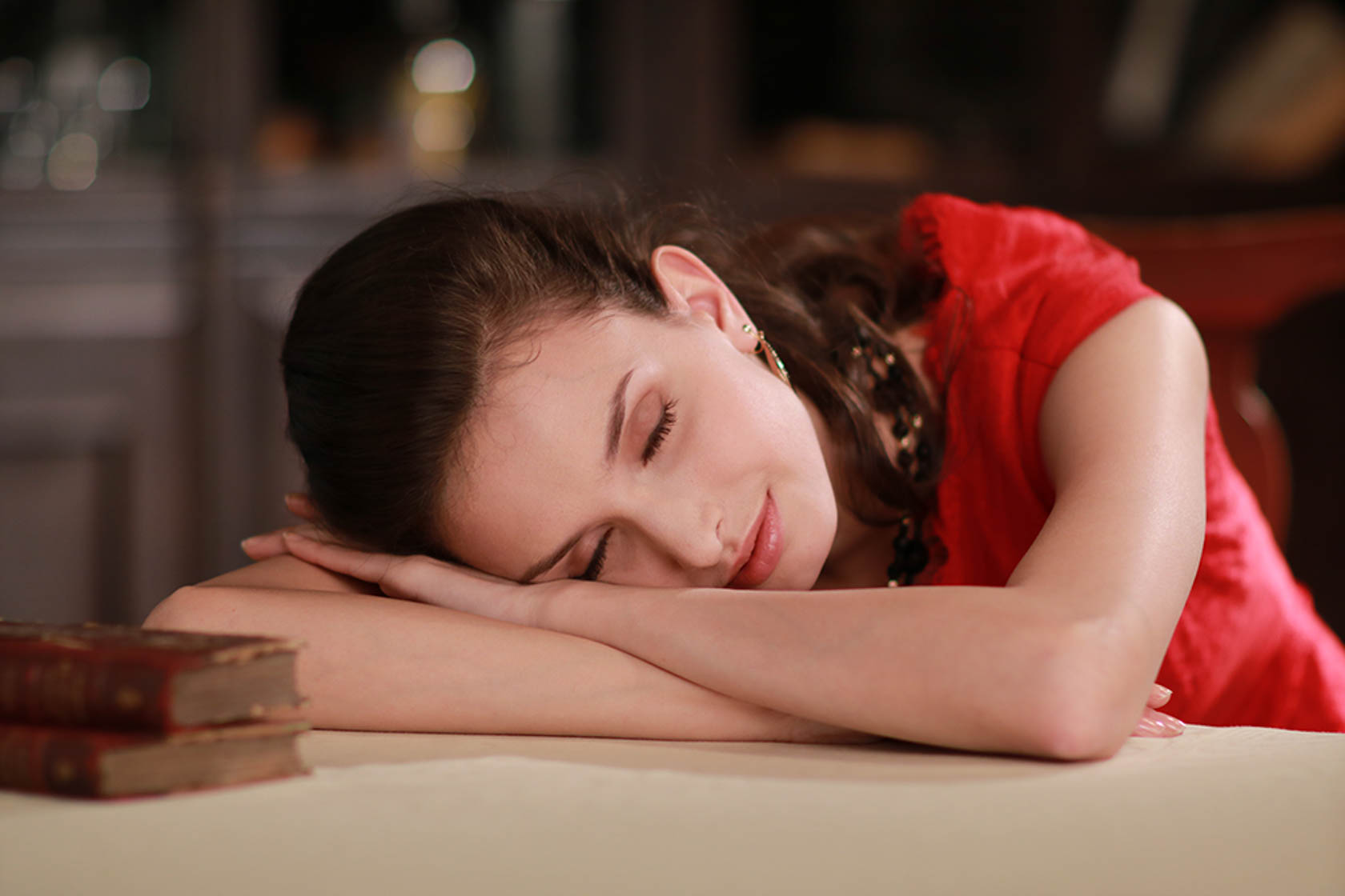 Girl sleeping on a desk taken with the Canon EOS 760D digital SLR camera