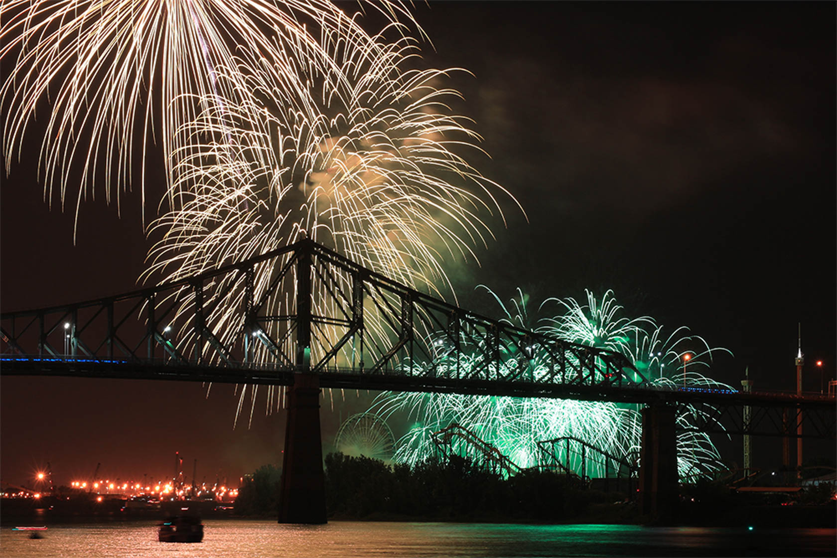 White and green fireworks over bridge shot on Canon EOS M10 Compact System Camera