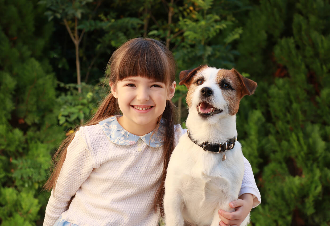 Portrait image of girl and dog taken with EOS M50