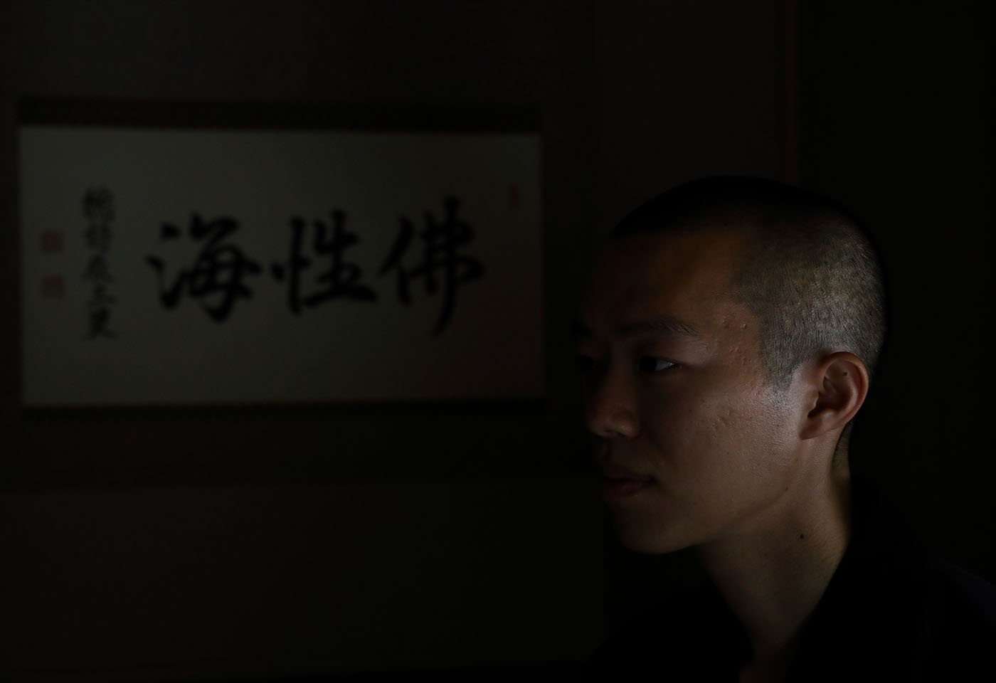 Portrait of a Japanese monk in low light, taken with the EOS R