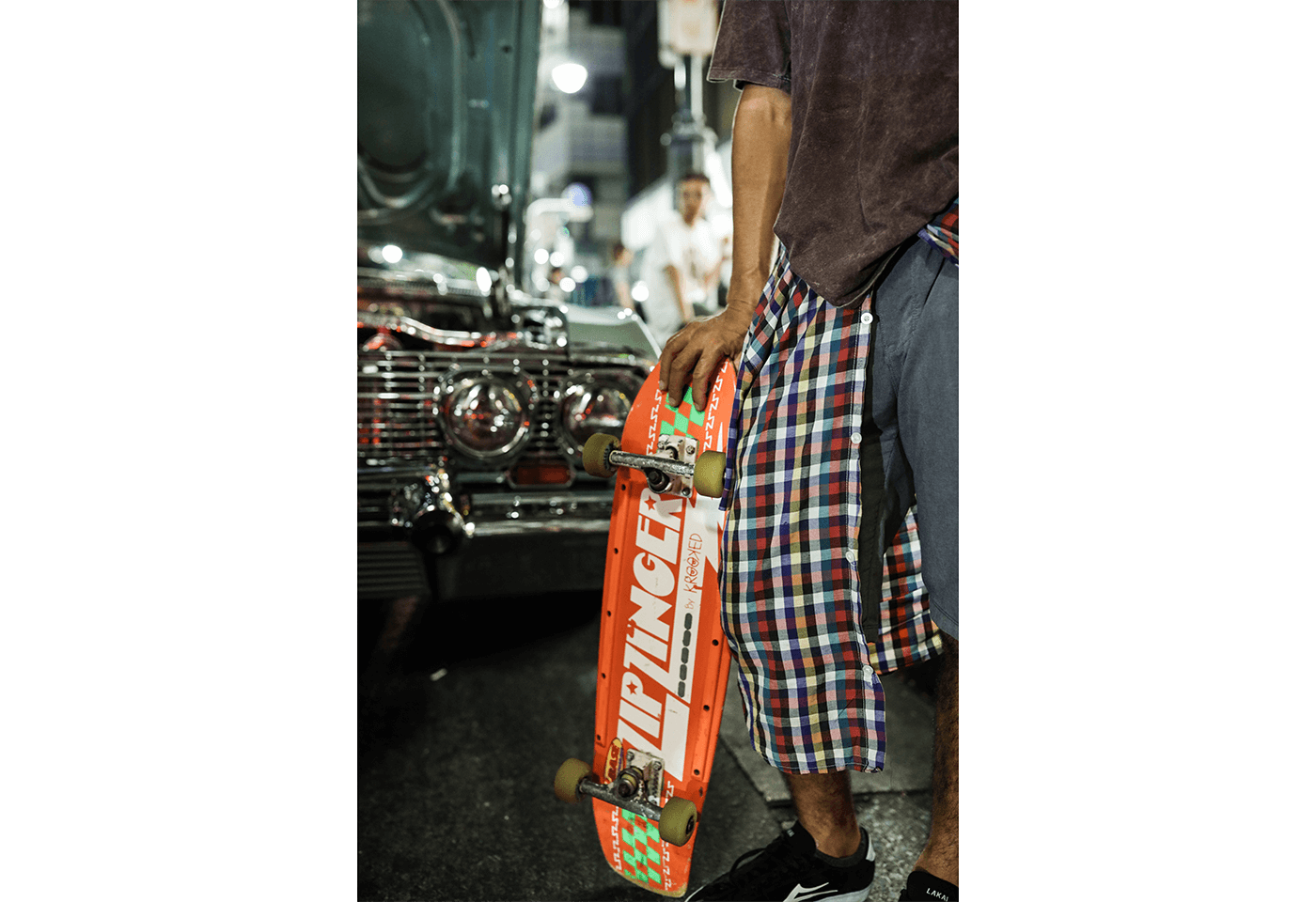 Photograph of man holding skateboard taken using RF 28-70mm f/2L USM