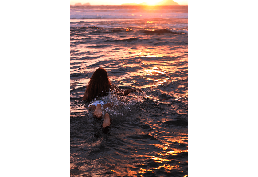 Photograph of girl in water at beach taken using RF 50mm f/1.2 L USM