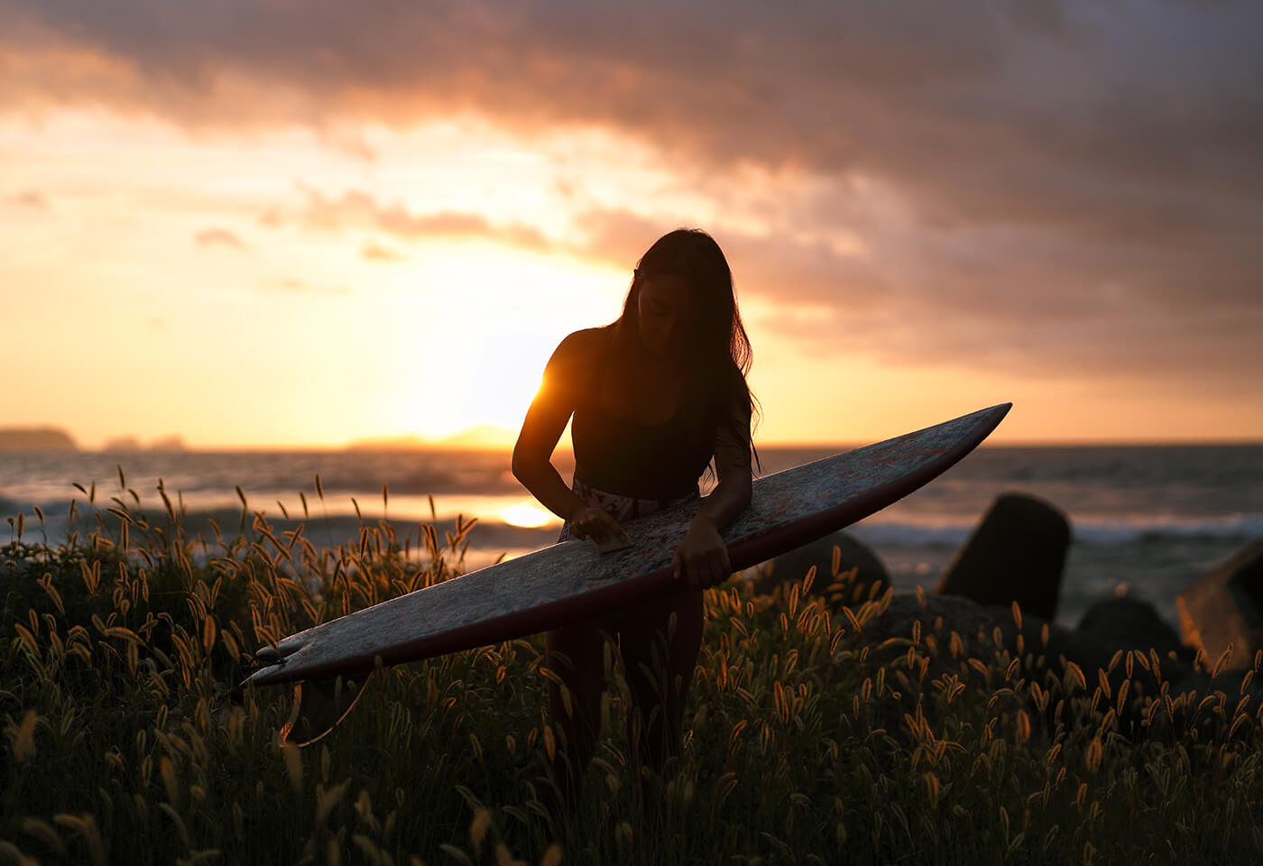 Photograph of girl with surfboard at sunset using RF 50mm f/1.2 L USM