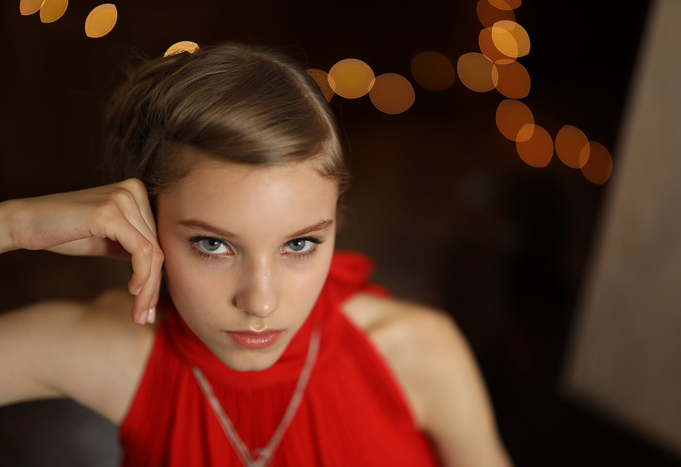 Photograph of model in red dress taken using RF 50mm f/1.2 L USM