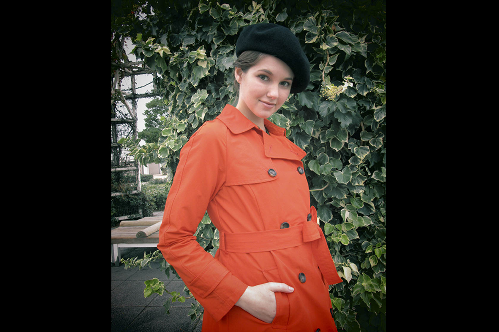Image of a girl wearing an orange trench coat shot on the IXUS 180