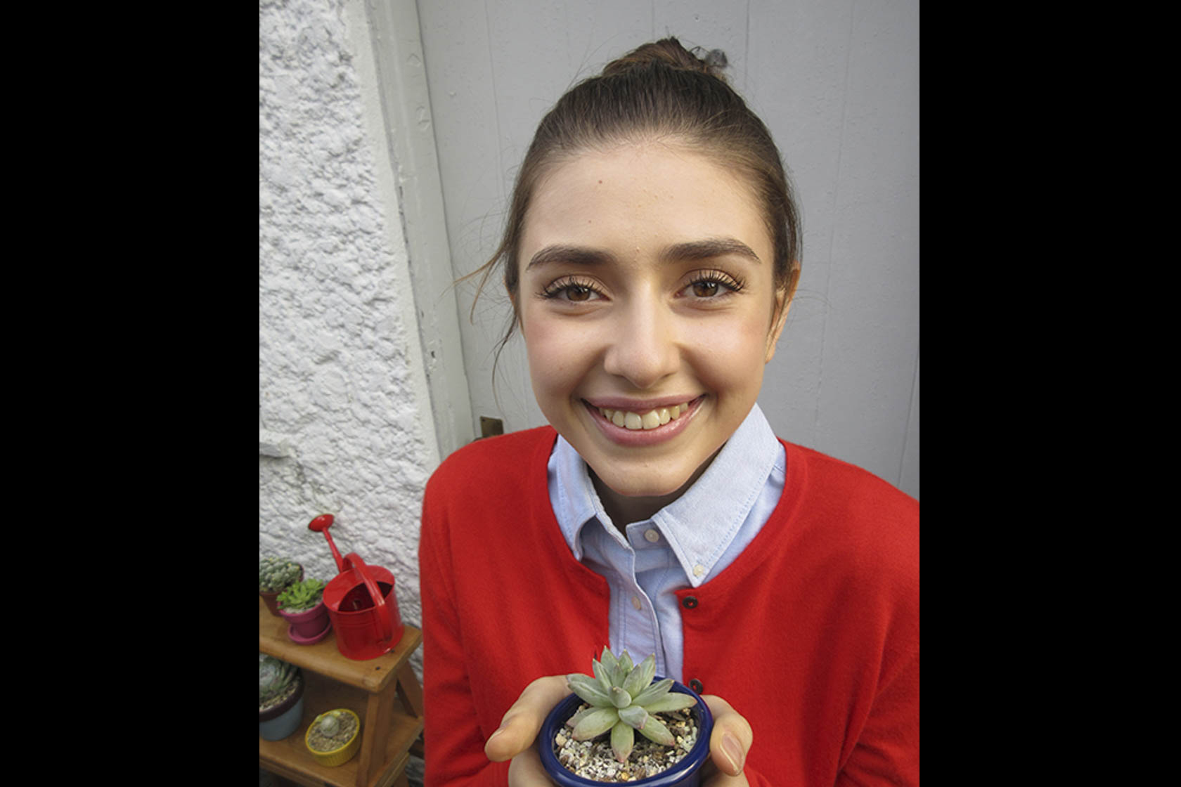 Girl holding a succulent taken with Canon IXUS 285 HS digital compact camera