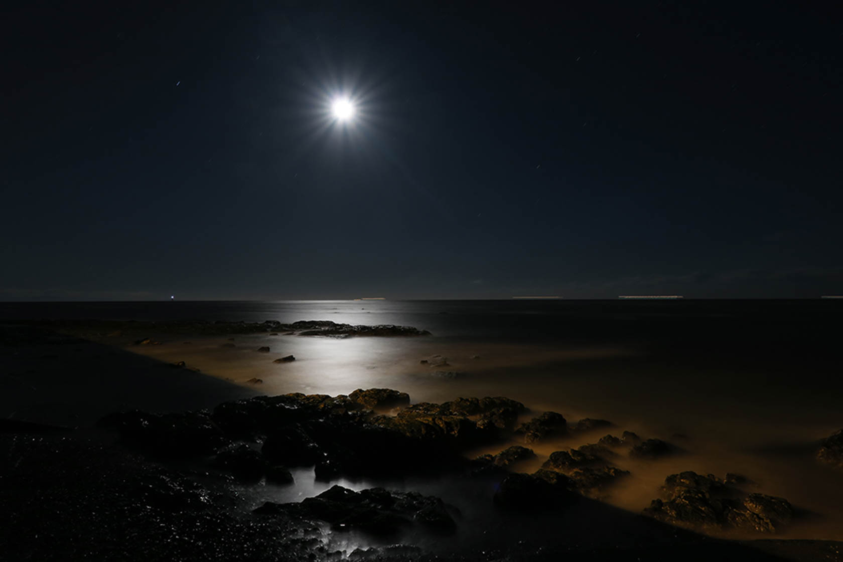The moon over a dark beach shot on the PowerShot G3 X