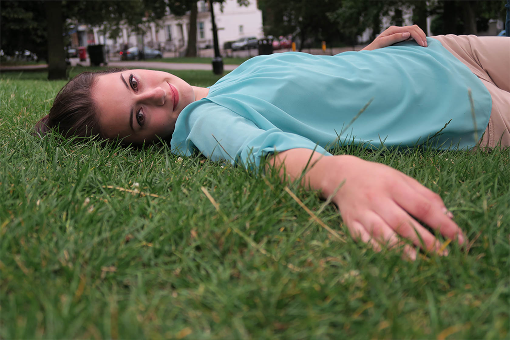 Girl lying in grass shot on PowerShot G5 X Digital Compact Camera