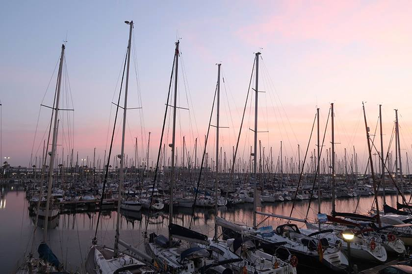 Photo of many boats docked in harbour at dusk shot on PowerShot G7X Mark II