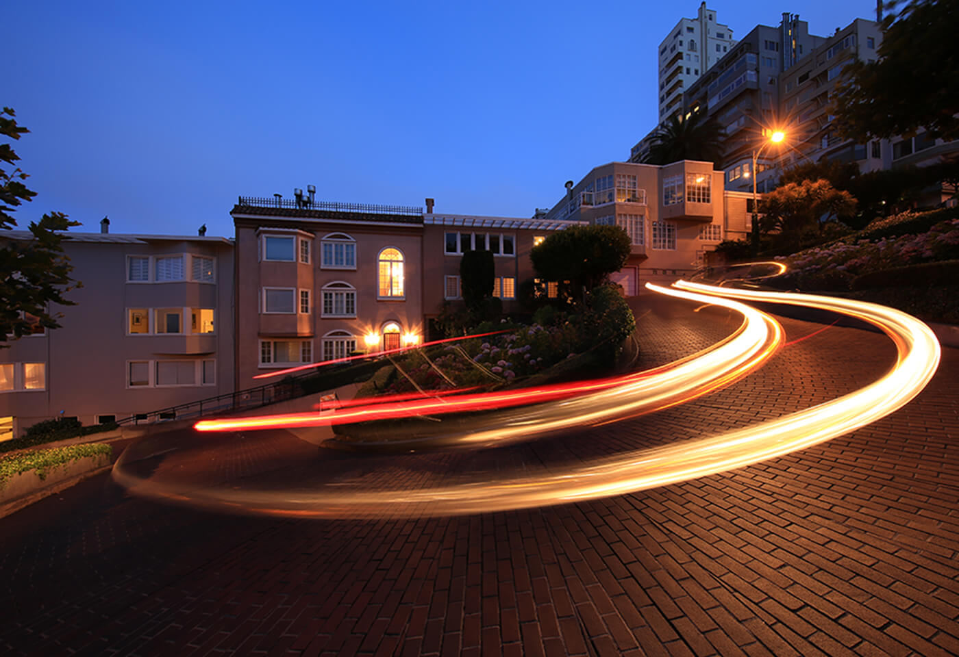 Image of a light trail left by a car on a winding road at night taken with the Canon EF 11-24mm f4L USM wide zoom lens
