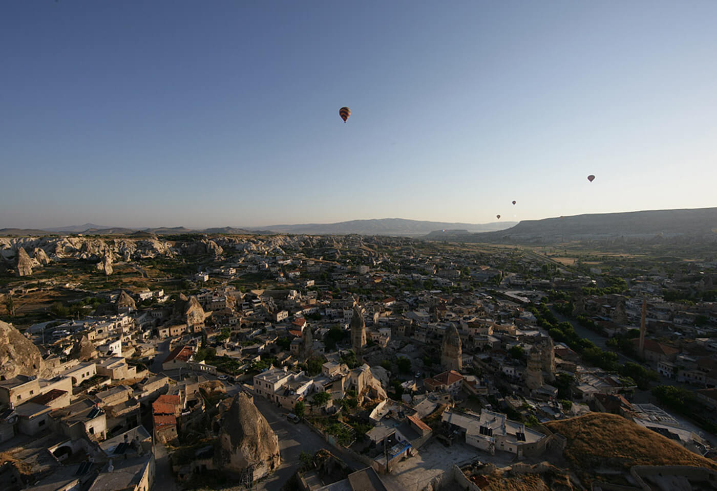 View of hot air balloons over town