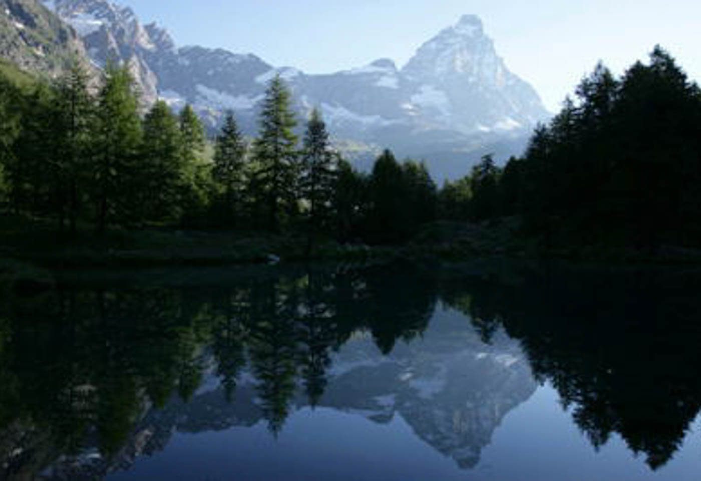 Reflection of a mountain and trees in lake