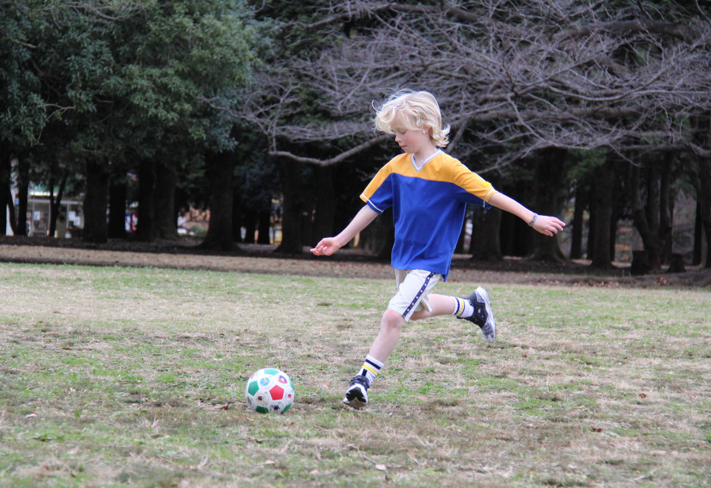 Kid playing soccer taken with Canon EOS 1300D DSLR camera