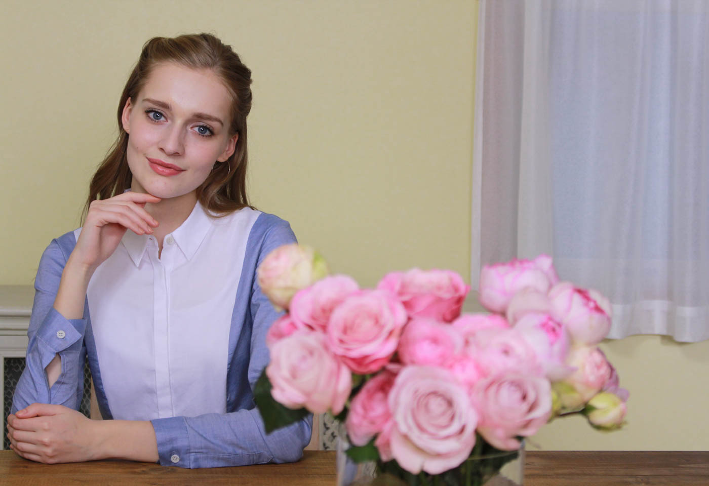 Girl with roses taken with Canon EOS 1300D DSLR camera