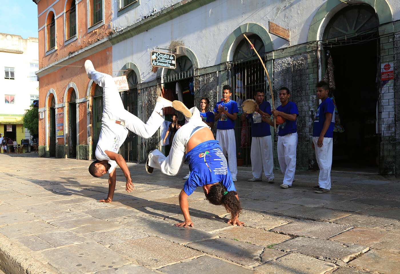 Men performing handstands