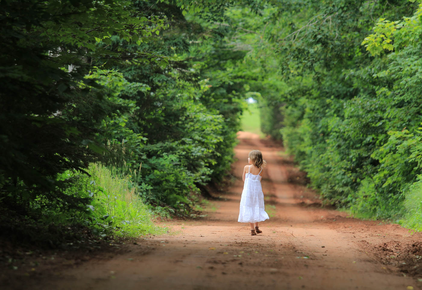 Young girl walking along a path taken by Canon EOS M10 mirrorless compact camera