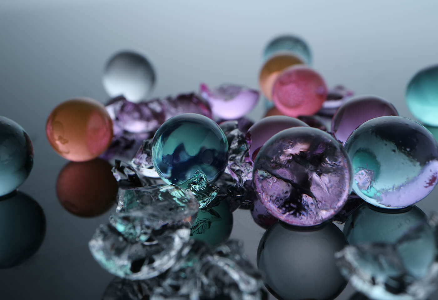 Marbles on reflective surface
